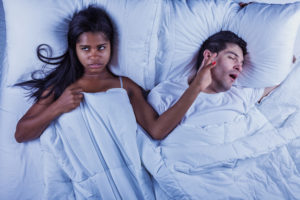 Man snoring keeps annoyed partner awake